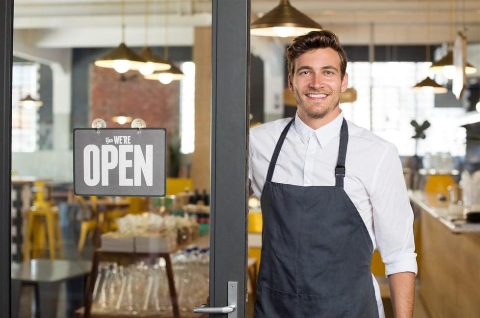 happy-restaurant-owner-standing
